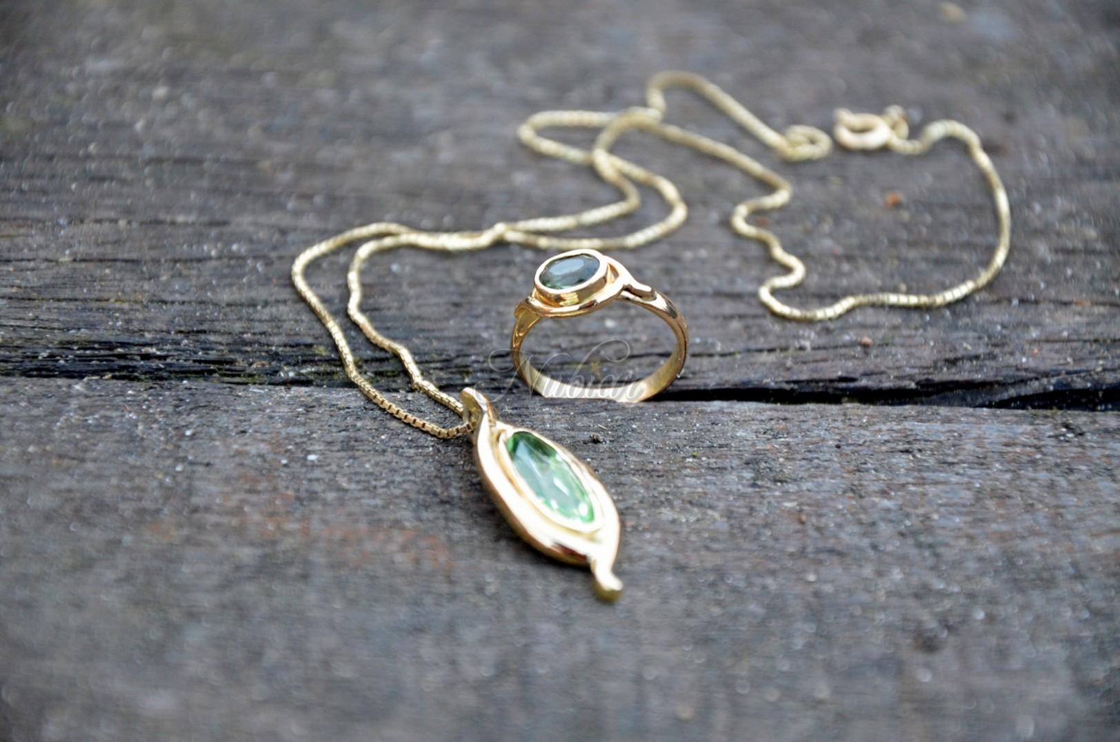 gouden ring met hanger laten maken